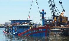 ベトナム・ダナン(Danang)の造船所に係留中の、中国船に沈没させられたと報じられているベトナムの漁船「DNA 90152」。(2014年6月2日撮影)。(c)AFP ▼5Jun2014AFP|G7開幕、東・南シナ海での緊張に懸念表明