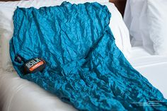 The Best Sleeping Bag Liner | The Sea to Summit Premium Silk Travel Liner wicks moisture, doesn't retain smells, and packs down to the size of an apple and even weighs less than one. It makes scratchy motel and hostel linens a lot more bearable.