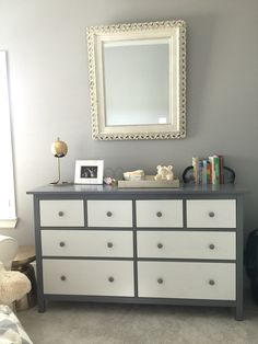 IKEA hack project with the all white hemnes dresser. Painted parts of it grey and added some new hardware from World Market. Perfect addition to our nursery!