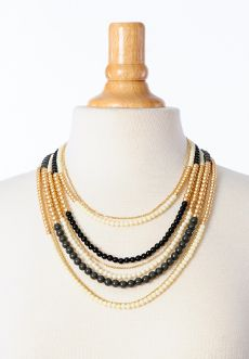 "Homecoming Trunk Shows - Layers of black, ivory and gold tone beads are perfectly hand paired in this bold statement necklace that will quickly become a favorite.    Longest Length: 23""  Shortest Length: 15""  $32.00  www.cwickline.shophts.com"