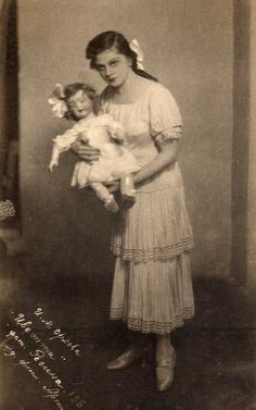 Woman with a toddler doll