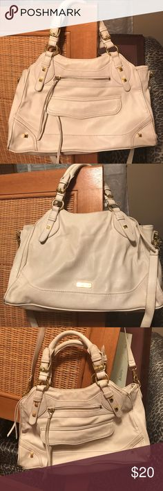 Ivory and gold moto purse Used but in great condition! Love this purse, very chic and comfortable. It has a crossbody strap and handles with plenty pockets. No damages besides normal wear on the 4 corners. Also a small pen stain in the corner shown in the 4th picture Jessica Simpson Bags Crossbody Bags