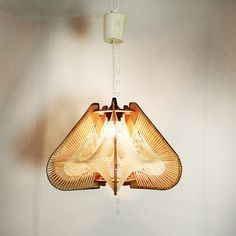 Scandinavian hanging light in wood and string.
