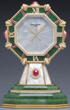The Nephrite Scholar Clock. A very rare yellow gold, silver, diamond, ruby, mother-of-pearl and nephrite Octagonal Desk Clock. Ref: 2042 MVT 8517 Case Made in 1989 Tabletop Clocks, Mantel Clocks, Patek Philippe, Art Nouveau, Radios, Antique Clocks, Vintage Clocks, Antique Watches, Desk Clock