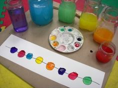 "Colorful music: Fill jars with different amounts of water and color each one a different color. Put out a metal spoon to ""play"" the jars with and also put out paper and watercolor paints in corresponding colors. Children can write music!"