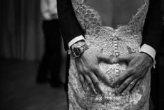 Factors affecting wedding photography prices include: your location, your wedding date (off-season and mid-week weddings will save you money), how much of the day the photographer is there for, going digital only and hidden costs. This cute wedding photograph is from Dotty Photography. We love the heart hands.