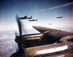 Lancaster B Mark Is of No 50 Squadron, Royal Air Force, based at Skellingthorpe, flying in spread formation. The two aircraft beyond the win...