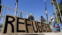 8 Syrian refugees turn themselves in at U.S.-Mexico border - CBS News