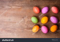 Natural dyed Easter eggs on old wooden background. Easter concept with copy space. Flat lay