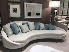 Make a statement with your sofa. Fluid curved sofas are on trend for 2017 - a shape inpired by nature.