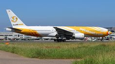 NokScoot (TH) Boeing 777-212(ER) HS-XBB aircraft, skating at Taiwan Taipei Taoyuan International Airport. 02/10/2016.