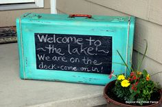 The most charming beach sign ever!  One old painted suitcase with a blackboard painted area to leave a chalk message.  Love it!