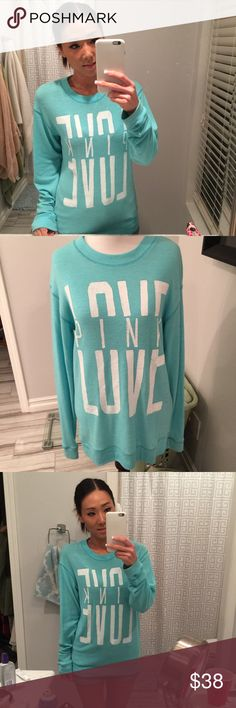 VS Pink Aqua crew neck stretch sweater In very good used condition! No flaws! No stains, discoloration, holes, snags, no stitching coming undone. Just minimal pilling from washing (normal with this sweater fabric). Super stretchy and extremely comfy and soft. Gorgeous Aqua color that really pops! White lettering. Banded at sleeves and hem. Rounded crew neckline. My all time fave sweater. So sad to part with this. 😭 PINK Victoria's Secret Sweaters Crew & Scoop Necks