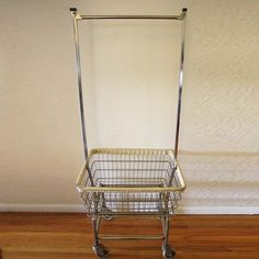 Rolling Laundry Cart. If you can't find it, then DIY it: A clothes rack + wire hamper basket + wheels = magic.