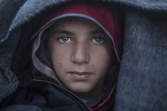 timelightbox:  PHOTO: ALI ALIIn the Eyes of a Young Syrian RefugeeAt the sprawling tent city on the Greece-Macedonia border, a photographer meets a boy aiming for Germany