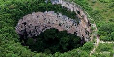Sima de las Cotorras, Spanish for Sinkhole of Parrots, is a giant circular sinkhole in the karst plateau of the Mexican state of Chiapas. It is noted for the thousands of green parakeets inhabiting the trees at its bottom and the ancient paintings on its cliff wall 70 metres (230 ft) underground.