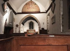 In England You Can Camp in Medieval Churches | View of St. Mary the Virgin church from church pew.