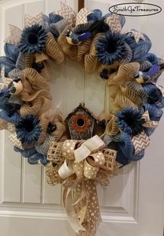 Deco Mesh Spring Wreath with birds, flowers, and a birdhouse. With this festive country wreath hanging on your door, you will be the envy of the