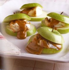TRACEY'S CARAMEL APPLE S'MORE : 1 marshmallow, 2 chewy caramels, 2 green apple slices, about 1/2-inch thick. Skewer the marshmallow followed by the two caramels on the same roasting stick. Roast until golden. Slide concoction onto one of the apple slices, top with remaining slice...