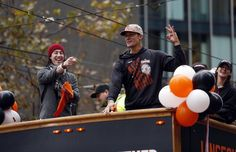 San Francisco Giants' Tim Lincecum and Javier Lopez during World Series Parade on Market Street in San Francisco. on Friday, October 31, 2014. Photo: Scott Strazzante, The Chronicle