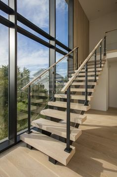 Keuka Studios custom fabricates Modern Glass Staircase Railings and Deck cable railings to fit your style and homes requirements. Modern Stair Railing, Stair Railing Design, Home Stairs Design, Glass Stair Railing, Glass Stairs Design, House Staircase, Staircase Railings, Spiral Staircases, Stair Treads