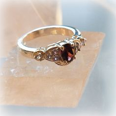 "The gorgeous ring - crystal of Garnett and a topaz, an angel, and healing one-house house"" Crystal Garden Mejiro "" Crystal Garden, Topaz, Healing, Wedding Rings, Angel, Engagement Rings, Crystals, House, Jewelry"
