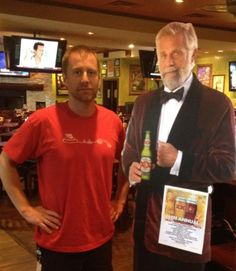 Is that The Most Interesting Man In The World? Yes, it is Mike Norton. He's posing next to a cut out of some random guy in a tux.