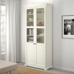 LIATORP white, Bookcase with glass-doors, cm. The delicate shapes and details remind of country living. Combine with other furniture in the LIATORP series for a complete, beautiful look. Bookcase With Glass Doors, Glass Cabinet Doors, Glass Shelves, Interior Barn Doors, Home Interior, French Interior, Luxury Interior, Ikea Liatorp, Buffet Vitrine