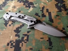 All the fine fit and finish you would expect from a Rick Hinderer custom knife on a Kershaw beer budget, Sturdy frame lock, no wiggle after lock-up and a great deep carry pocket clip.  At a mere $30 or so--go on 'head and getchu one!