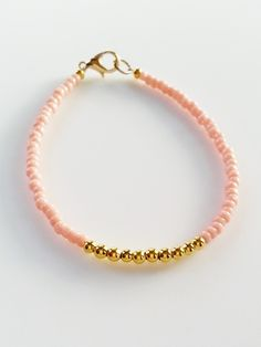 This wonderful friendship bracelet is made with pink and gold beads. A beautiful and gentle color combination looks great and can be stacked with other beaded bracelets for a layering effect. BFF stac