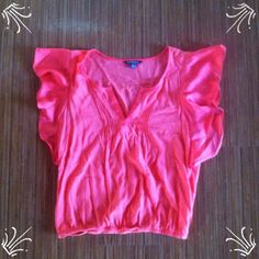 Coral American Eagle Outfitters Top This coral, American Eagle Outfitters top is absolutely gorgeous!! It has beautiful, flowy sleeves and the front of the top has very nice detailing! There is elastic at the bottom of the shirt so it gets a bit tighter. This shirt is a size small an is just so pretty! American Eagle Outfitters Tops