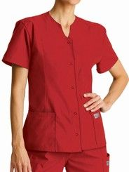 Scrub Zone is a new economy scrub brand by Landau featuring a wide variety of colors and styles at an affordable price. Landau ScrubZone Snap Front Tunic with notch neckline. Set-in sleeves. 5 matching snap ring closure. Two large front patch pockets. Hidden accessory tape in right pocket to hold instruments and maximize storage. Front and back princess seams for a flattering fit. Side slits for ease of movement. 65/35 Poly/Cotton.