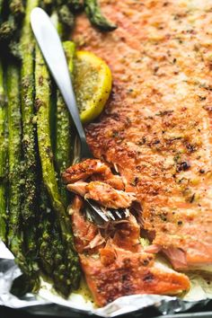 Baked Lemon Parmesan Salmon & Asparagus in Foil ~ flaky and perfectly baked in foil ...  an easy and healthy 30 minute meal with fantastic flavor .    lecremedelacrumb.com