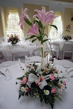 Lily Topairy centerpiece with sheer wired ribbon bows nestled at base of floral.