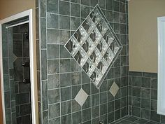 Glass block...An awesome way to get light into your shower, make it feel bigger and add something different to bathroom. See more ideas on our FaceBook page https://www.facebook.com/media/set/?set=a.432632999508.233170.114264044508=3=3adaab1209