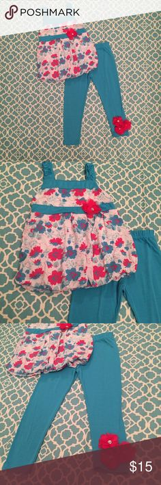 Diva Girls Outfit NWOT! Never worn, only tried on. Pants are long for 2T and when my daughter could wear them, her closet style changed and I never had a chance to put it on her.    Sleeveless floral bubble top with solid blue pants with flower ankle detail. Diva Matching Sets