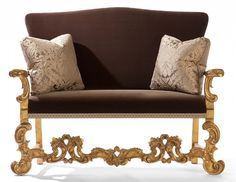 Adorno Settee from Collection Ten by @ebanistacollect. Hand-carved settee with elaborately scrolled stretcher. Available in antiqued and distressed 22k gold or antiqued and distressed silver finish. Does not include decorative pillows as shown. Upholstered in Ebanista's Chanel Bronze silk velvet with Renaissance Braid Bronze decorative tape trim. Discover more at www.ebanista.com #livingroom