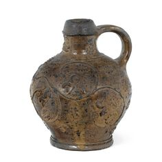 A RHENISH POSSIBLY COLOGNE STONEWARE JUG LATE 16TH/17TH CENTURY the globular brownish glazed body moulded with garlands of oak and acorns height 19cm.