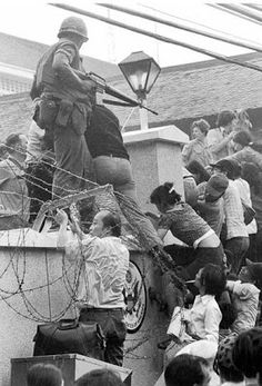 "Real Vietnam Pic - scaling the US Embassy Wall prior to the fall of Saigon - ""TAKE ME WITH YOU!"""