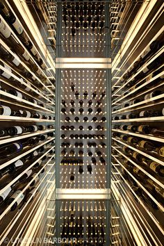 A mirrored wine cellar creates an illusion of infinate depth. Interior designed by Andee Hess of Osmose.