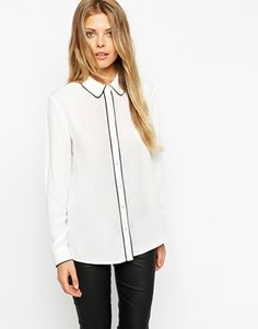 ASOS Blouse - Love the black piping, wear with a black skirt or pants. get it here: http://us.asos.com/ASOS-Blouse-With-Contrast-Piping/14rc6d/?iid=4642995&cid=11318&sh=0&pge=1&pgesize=36&sort=-1&clr=Ivory%2fblack+trim&totalstyles=262&gridsize=3&mporgp=L0FTT1MvQVNPUy1CbG91c2UtV2l0aC1Db250cmFzdC1QaXBpbmcvUHJvZC8.