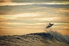 Tyler Wright, a nice wave, and a beautiful sunset. Shot by @trentmitchellphoto