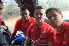 Making friends: Calum Chambers  with Alex-Oxlade Chamberlain and Wojciech Szczesny in Aust...