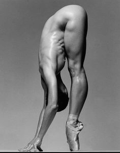 male ballet dancer {amazing muscles, but wouldn't you think something would be showing along the right upper side of him?