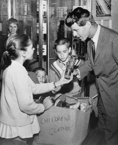 Robert Kennedy Donating Shoes to Save the Children's shoe drive Ethel Kennedy, Caroline Kennedy, Robert Kennedy, Famous Legends, Jfk Jr, Greatest Presidents, Music Licensing, American Spirit, Save The Children