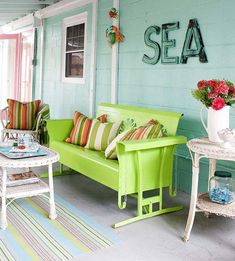 Beach Cottage Decor - oh so perfect-- beach house porch. This laid-back living space gets its look from bright, beachy colors. Light blues, greens, oranges, and pinks pair with white for an inviting atmosphere. A traditional porch swing was converted into Outdoor Rooms, Outdoor Living, Outdoor Furniture Sets, Outdoor Decor, Outdoor Signage, Outdoor Ideas, Porch Furniture, Iron Furniture, Living Furniture