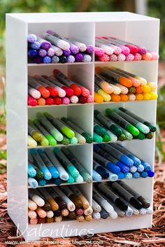A cool looking shelved container for storing copic markers.