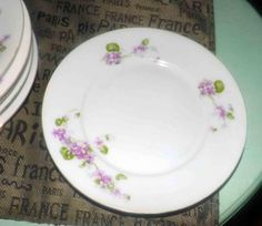 Antique (c.1900-1909) Victoria China Austria hand-painted salad plate. Sprays of pink flowers, smooth gold edge. Flawed (see below).