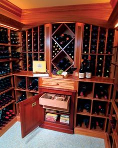 Wine cellar with a humidor. Will be in my man cave one day.