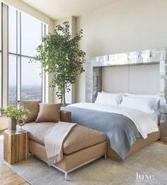Contemporary Cream Master Bedroom with Steel Headboard
